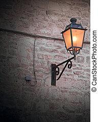 Street lamp on brickwall.