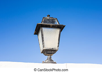 Street lamp on the blue sky background