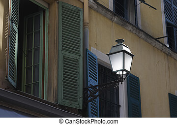 Street lamp on the facade of a building