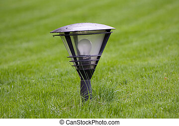 street lamp on the green grass