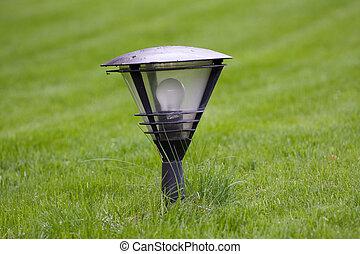 street lamp on the green grass