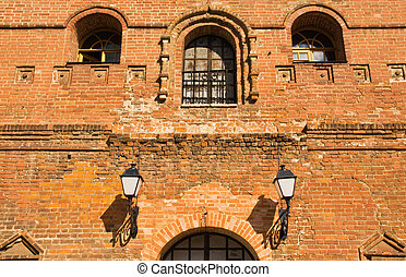 Street lamp on the wall of old brick building
