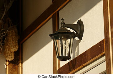 Street lamp on the wall of the house. Interior. The photo