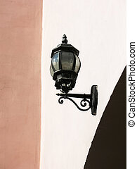 Street lamp on the wall. St. Petersburg