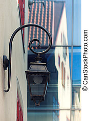 Street lamp on the wall with reflection