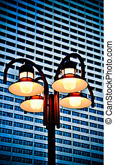 Street lamp with building background.