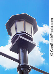 street lamps, high on the road.