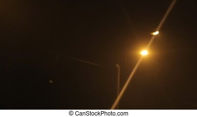 Street lamps in the twilight, the view from the car