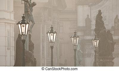 Street lamps on Charles bridge in the morning Prague