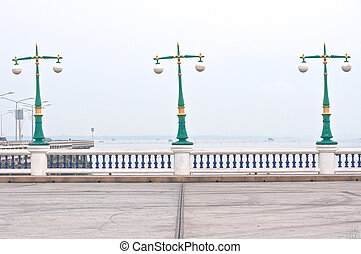 street lamps on cloudy day