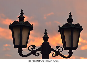 street lamps on sky at sunset
