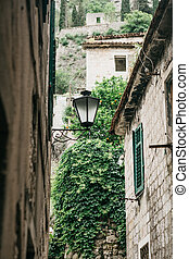Street lamps on the outside of a stone apartment building