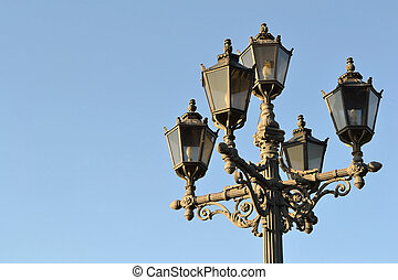 Street lantern on blue sky background