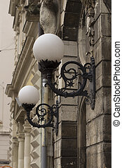 Street lanterns on the wall of a building