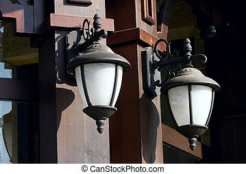 Street lanterns on the wall of a st