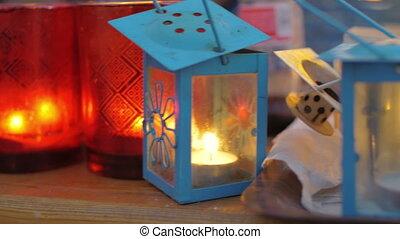 Street lanterns with burning candles - Close-up shot of...