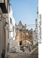 Street leading to cathedral in Ostuni, Italy