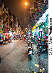 Street life of Hanoi at night in Vietnam, Asia.
