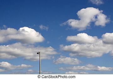 street light against a blue cloudy sky