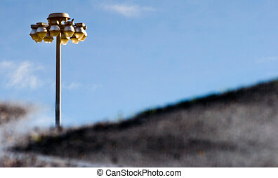 Street Light and Sky Reflected in a puddle - Photograph of a...
