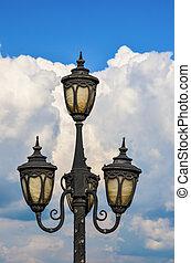Street light - Detail of street lamp against blue sky and ...