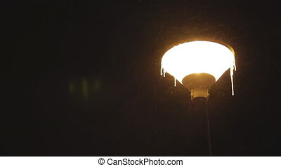 street light lamp at night - street light lamp under snow at...
