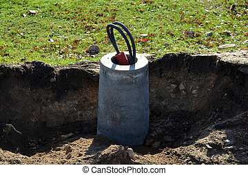 Street light lamp concrete base with cable in street