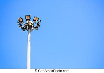 Street lighting or spotlight lamp against blue sky background