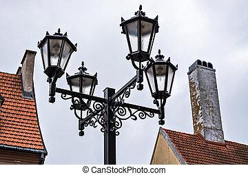 Street lights against the sky.