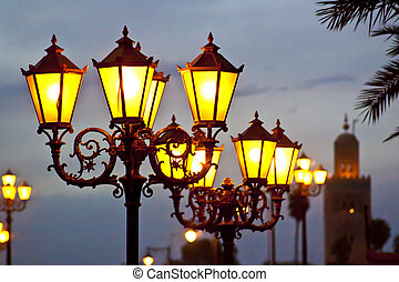 Street lights in Marrakesh with Koutoubia Mosque near Jemaa...