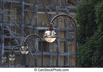 Street lights on the background of scaffolding
