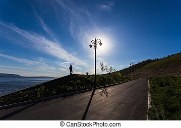 Street lights on the promenade of great river