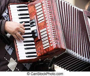 Street musician - Musician playing on accordion on city...