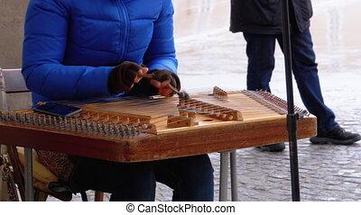 Street Musician Plays a Musical Instrument - Folk Cimbalom....