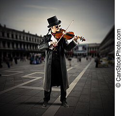 Street musician - Violinist plays on a square with people...