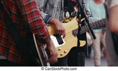 Street Musicians Playing a Guitars