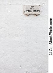 Street name plate - Italian street name plate on a white...