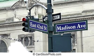 Detailed view of a street name sign in Manhattan, New York.