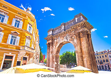 Street of Pula with historic Roman Golden gate view, Istria...