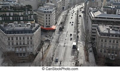 street of wintry Paris, view from Triumphal Arch