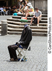 Street performer is showing a magical trick, body without a...