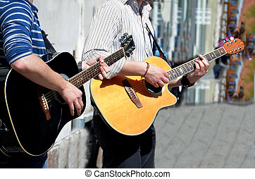 Street  performer playing guitar