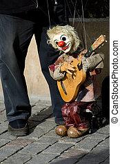 Street performer with doll on Charles bridge, Prague