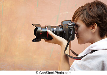 street photography - female photographer with professional...