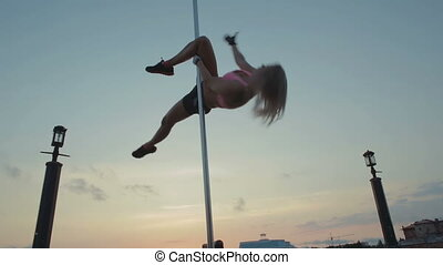 Street Pole dance on sunset stock footage video