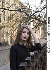Street portrait of attractive woman at the city