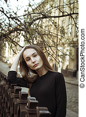 Street portrait of beautiful woman at the city