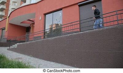 Street runner man vaults over a hand rail front flips down...