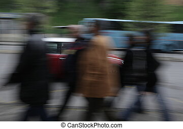 Street scene - people rushing in all directions - some...