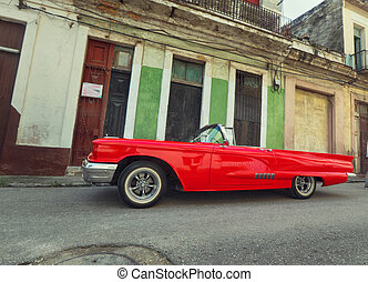 Street scene with colorful buildings and old american  downtown Havana